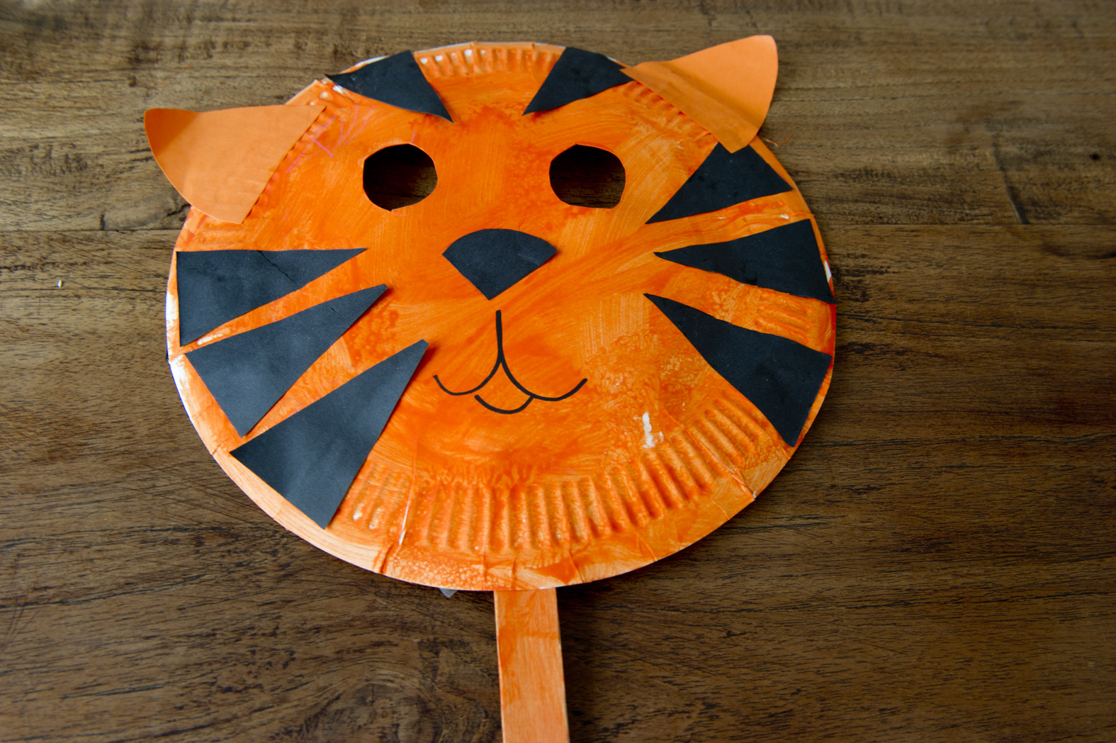 White paper plates. Penknife Orange paint u0026 paint brushes. Craft sticks or ice cream sticks. Scissors One sheet of black construction paper & Craft for Kids: Tiger Mask | The Little Singapore Book Companion